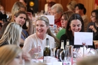 GREAT SUPPORT: Marea Carney (left) and Amelia Riwai, both of Napier, smiling for a good cause at the Business Belles Charity lunch held at the Mission Estate Winery and Restaurant last Friday. PHOTO/DUNCAN BROWN