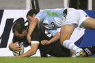 Leon MacDonald of the All Blacks scores a try in the 2006 win over Argentina. Photo / Getty