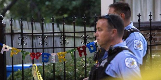 A 'Happy Birthday' sign hangs outside a residence near the scene of a shooting in Chicago over the Labor Day weekend. Photo / AP