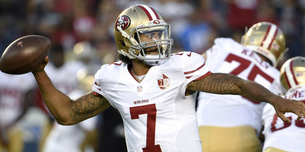 San Francisco 49ers quarterback Colin Kaepernick maybe in hot water over his controversial actions, but his jersey sales are through the roof. Photo / AP