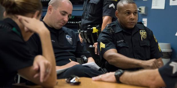 Sergeant Ivan Gunter, right, speaks with members of the Foxtrot team. Photo / Washington Post