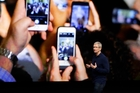Apple's new phone will accelerate the erosion of the global attention span. Picture / AP