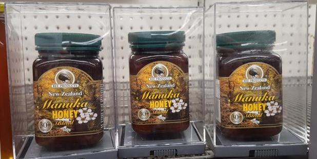 Pricey Manuka honey is kept in security cases at Preston, Melbourne Woolworths. Photo / Harrison Tippet, news.com.au