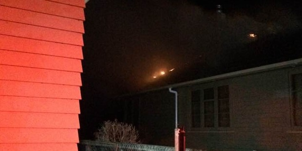 The glimmer of a house fire on Weka St that destroyed the kitchen and roof and left four children burnt. PHOTO/Facebook