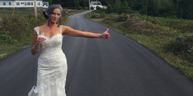 Angelique Arsenault hitchhikes a ride on her wedding. Photo / Angelique Arsenault Facebook