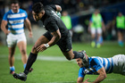 All Blacks wing Julian Savea slips the tackle of Argentina midfielder Juan Martin Hernandez. Photo / Jason Oxenham