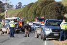 Emergency services at Otamarakau Valley Rd where a mother and her two young children were hit by a car. Photo/John Borren