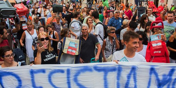 Hundreds of angry Venetians have protested tourism in their city, brandishing shopping carts and prams. Photo / Facebook