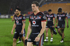 A dejected Warriors captain Ryan Hoffman leads his players from the field. Photo / photosport.nz