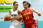 Akiene Reed of the Junior Tall Ferns drives past Saiqi Jia of China. Photo / Photosport