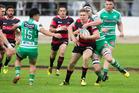 Jack Goodhue can't break the Canterbury defence. Photo / Photosport