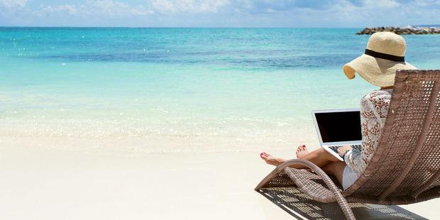 Wish you were here ... The out of office reply message is getting a Qantas makeover. Photo / 123RF