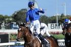 The kid sure loves riding a winner ... James McDonald aboard Astern at Rosehill on Saturday. Photo / News Ltd