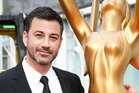 Host Jimmy Kimmel poses for a photo with an Emmy statue at the Primetime Emmy Awards. Photo/AP