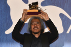 Filipino filmmaker Lav Diaz holds the Golden Lion award for his movie Ang Babaeng Humayo (The Woman Who Left) during the Venice International Film Festival. Photo/AP