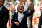 Democratic presidential candidate Hillary Clinton waves hours after her health scare. Photo / AP