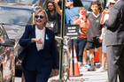 Democratic presidential candidate Hillary Clinton walks from from her daughter's apartment building in New York. Photo / AP