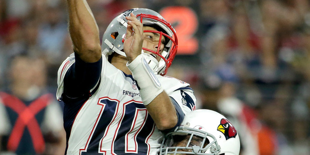 New England Patriots quarterback Jimmy Garoppolo is hit against the Arizona Cardinals. Photo / AP