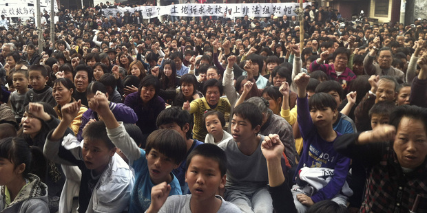 Villagers chant slogans as they gather for the 2011 protest in Wukan village, Lufeng city, in southern China's Guangdong province. Photo / AP