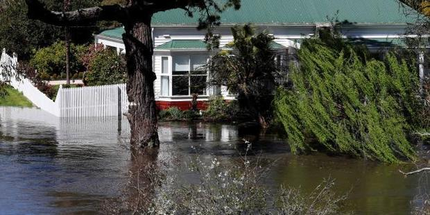 About 80 homes in Victoria have been flooded. Photo / David Geraghty