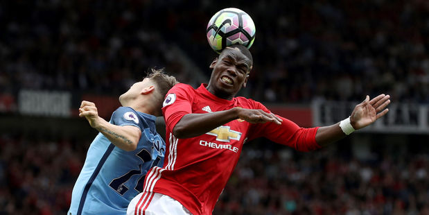 Manchester United's Paul Pogba (right) and Manchester City's John Stones battle for the ball during City's 2-1 win at Old Trafford early this morning (NZT). Photo / AP