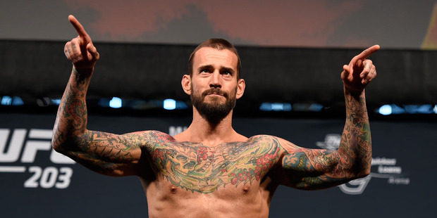 CM Punk lost in his UFC debut in lopsided fashion, but he's not walking away without a lot of money in his pocket. Photo / Getty Images.