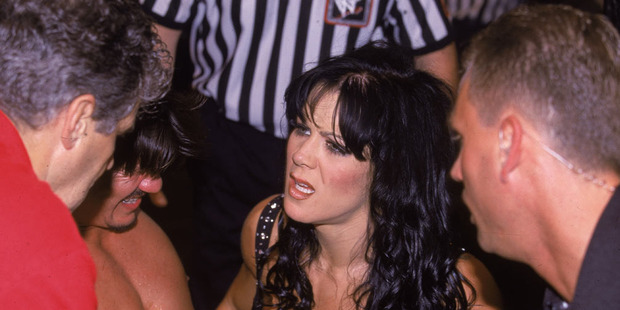 American wrestler Chyna (Joanie Laurer) attends to parner Eddie Guerrero ringside during a match at Madison Square Garden, New York, New York, early 2000s. Photo / Getty Images.