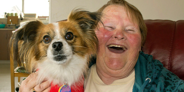 Coral Luscombe with her dog Poppy, that was hit by a car. Photo / Christchurch Star