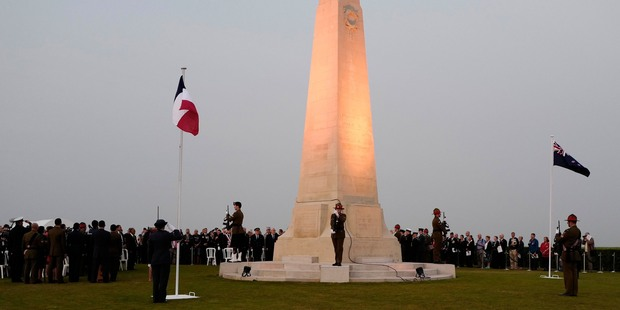 People stand during a ceremony to commemorate the 100th anniversary of the Battle of the Somme in the New Zealand Battlefield Memorial in Longueval, northern France. Photo / AP