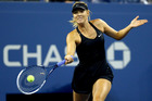 Maria Sharapova returns a shot during the 2014 US Open. Photo / Getty Images