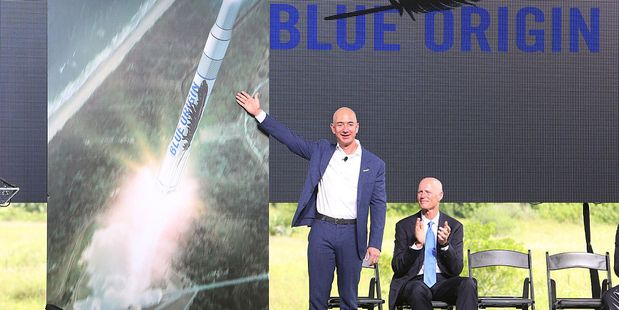 Blue Origin founder Jeff Bezos, left, debuts a launch vehicle in September last year. Photo / Getty Images