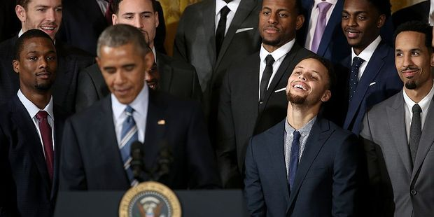 Stephen Curry (3rd R) laughs as U.S. President Barack Obama's jokes. Photo / Getty Images