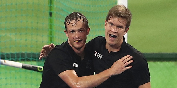 Hugo Inglis celebrates with team mate James Coughlan in Rio. Photo / Getty Images