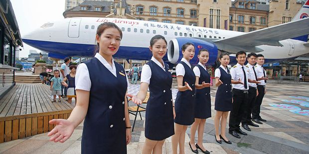 Staff are dressed like flight attendants and must meet hiring requirements of Chinese airlines. Photo / Getty Images