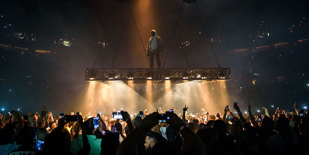 Kanye West spent the show suspended above the audience, performing on a stage that moved around the arena. Photo / Getty Images