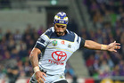 Cowboys playmaker Johnathan Thurston takes a shot at goal during their 16-10 qualifying final match against the Melbourne Storm last night. Photo / Getty Images