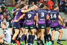 The Storm celebrate their win over last year's champions, the Cowboys, during round one of the NRL Finals. Photo / Getty
