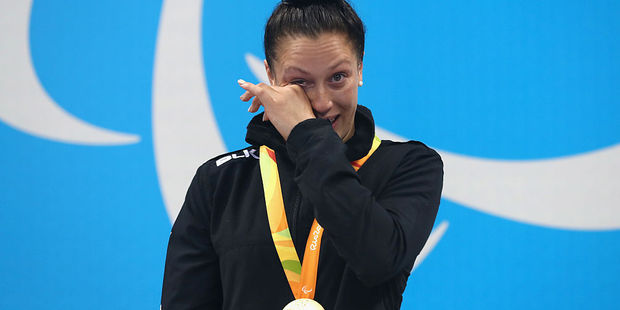 Gold medalist Sophie Pascoe shows her emotion on the podium at the medal ceremony for the Women's 100m Backstroke - S10. Photo / Getty