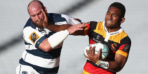 Sevu Reece of Waikato fends off Greg Pleasants-Tate of Auckland. Photo / Getty
