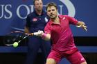 Stanislas Wawrinka in action against Novak Djokovic US Open men's final. Photo / Getty Images