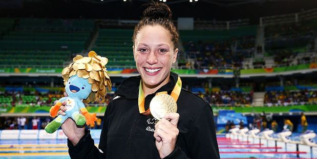Sophie Pascoe of New Zealand poses with her gold medal after winning the Women's 100m Butterfly S10 final. Photo / Getty