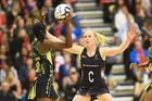 Adean Thomas of Jamaica and Laura Langman of the Silver Ferns. Photo / Getty