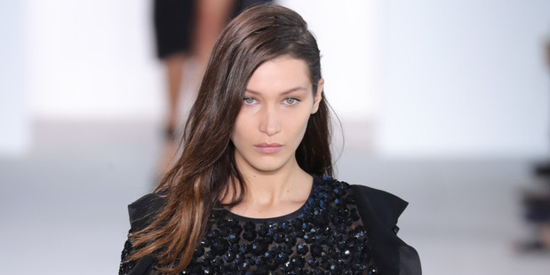 Bella Hadid walks the runway at Michael Kors show during New York Fashion Week and trips. Photo / Getty Images