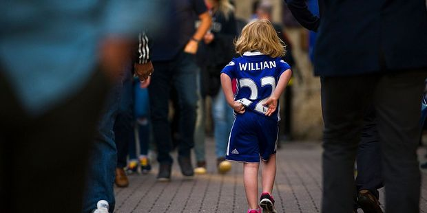 A young Chelsea fan arrives at Stamford Bridge. Photo / Getty Images