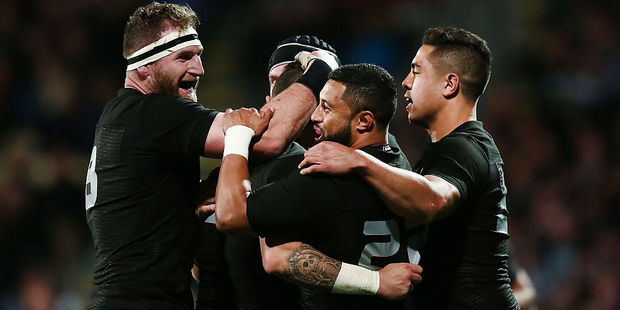 Loading TJ Perenara is mobbed by teammates after scoring a try. Photo / Getty
