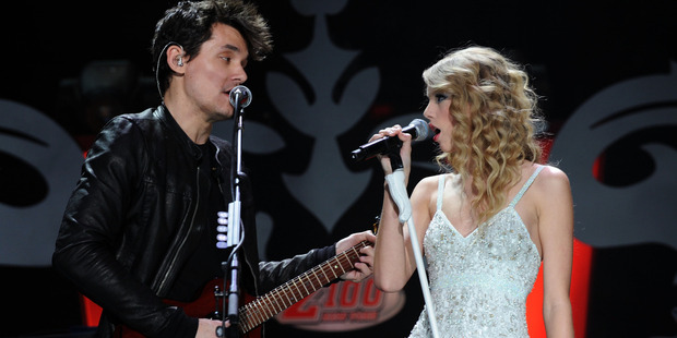 John Mayer and Taylor Swift perform onstage during Z100's Jingle Ball 2009. Photo / Getty