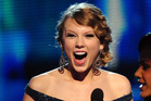 Taylor Swift receives an award onstage at the 52nd Annual GRAMMY Awards. Photo / Getty