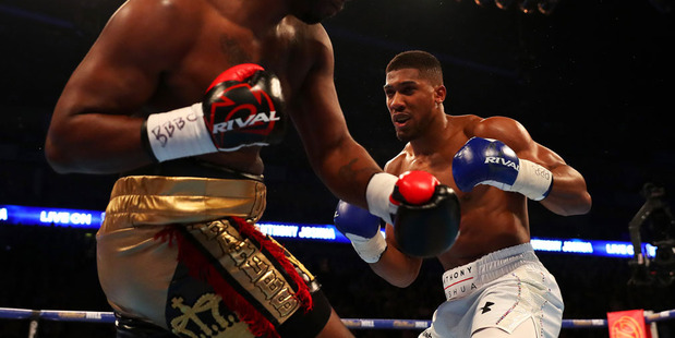 Anthony Joshua (r) is not worried about who his manager Eddie Hearn finds to fight him in his IBF heavyweight title defence. Photo / Getty Images.