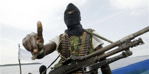 Militants wearing black masks, military fatigues and carrying Kalashnikov assault rifles and rocket-propelled grenade launchers roam Nigeria. Photo / AP