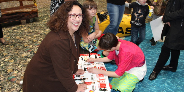 Rima Te Wiata signing Billy Elliot posters at Starship Hospital in Auckland. Photo / Supplied